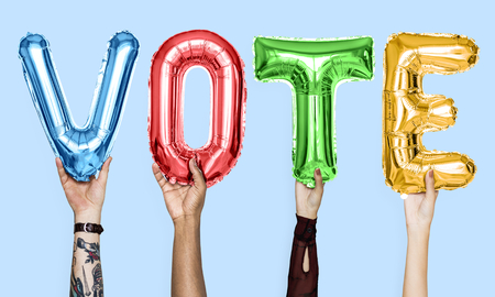 Colorful alphabet balloons forming the word vote