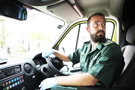 Male paramedic driving an ambulance