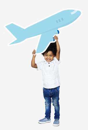 Happy boy holding an airplane icon