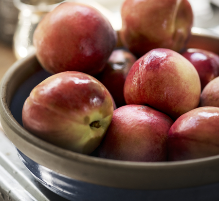 Fresh organic nectarines in a bowl