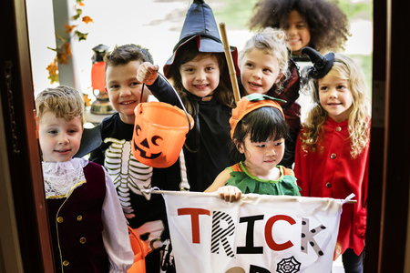 Little children trick or treating on Halloween Banco de Imagens