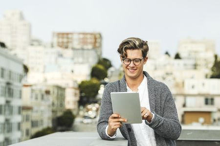 Man using a digital tablet at a rooftop in San Francisco Imagens