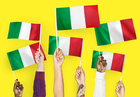 Hands waving flags of Italy