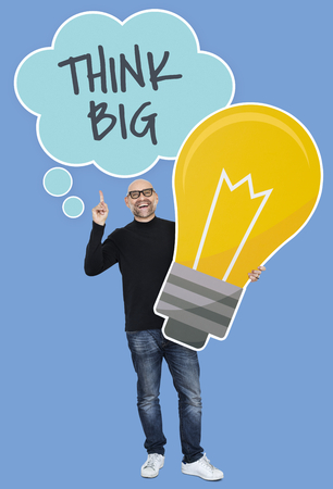 Man with Think big ideas holding a light bulb icon