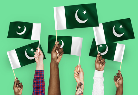 Hands waving flags of Pakistan Stock Photo