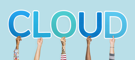 Hands holding up blue letters forming the word cloud Stock Photo