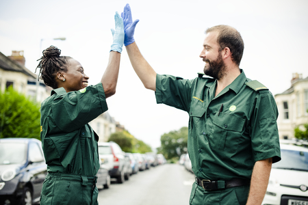 Team of paramedics doing a high five