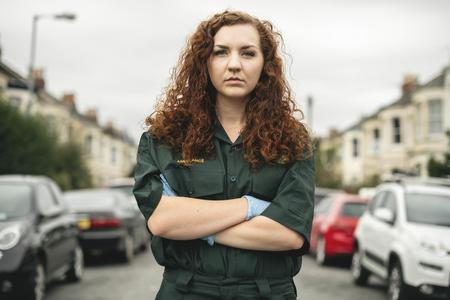 Portrait of female paramedic in uniform
