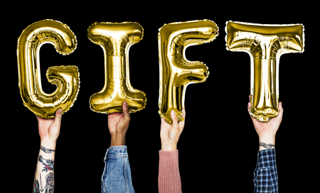 Hands showing gift balloons word Stock Photo