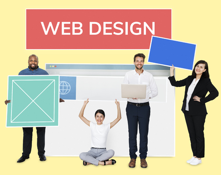 Happy diverse people holding a web design board