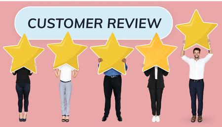 Diverse businesspeople showing golden star rating symbols