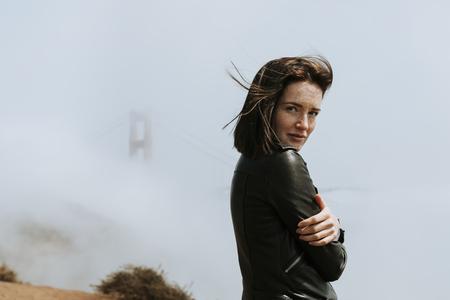 Woman with a misty Golden Gate Bridge, San Francisco