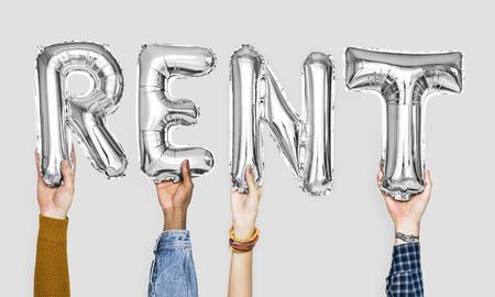 Silver gray alphabet balloons forming the word rent Standard-Bild - 111629893