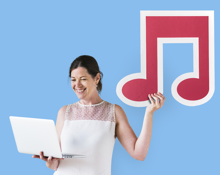 Woman holding a musical note and a laptop