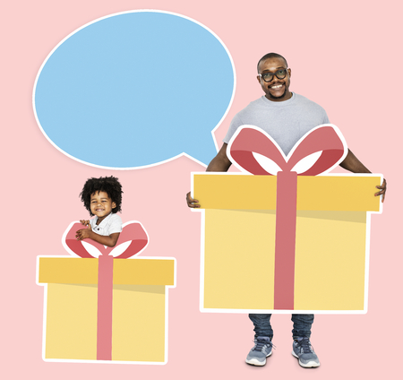 Father and son holding gift boxes Stock Photo