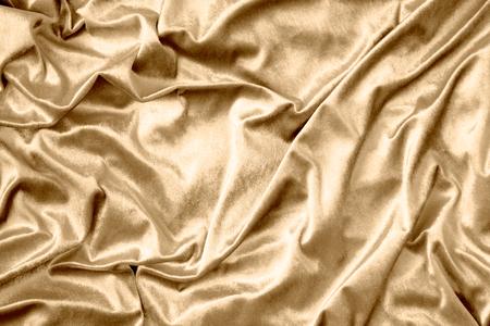 Golden shiny silk fabric texture