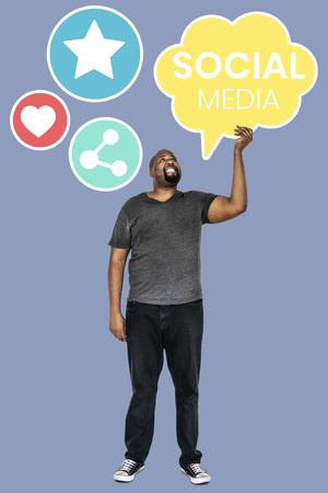 Man holding social media symbols