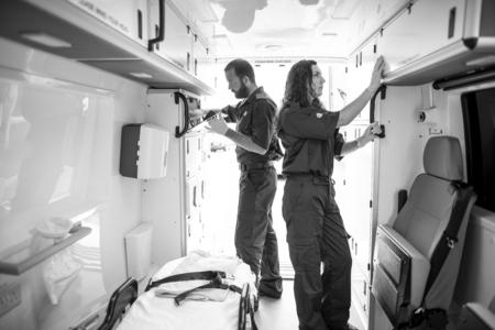 Paramedic team checking equipment in an ambulance 写真素材