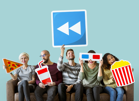 Group of diverse friends holding movie emoticons Stock Photo - 111778354