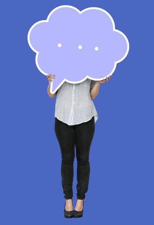 Woman holding a speech bubble symbol Stock Photo