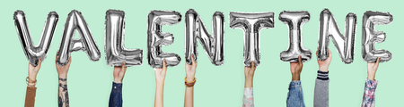 Gray silver alphabet balloons forming the word valentine