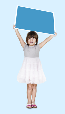 Happy girl holding an empty square board Stock Photo