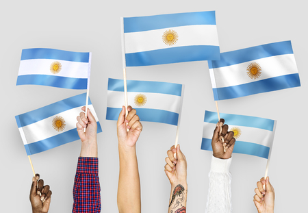 Hands waving the flags of Argentina