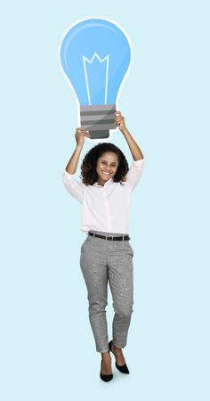 Businesswoman holding a light bulb