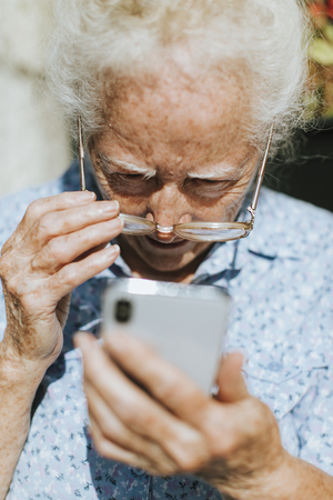 Senior woman reading from a mobile phone