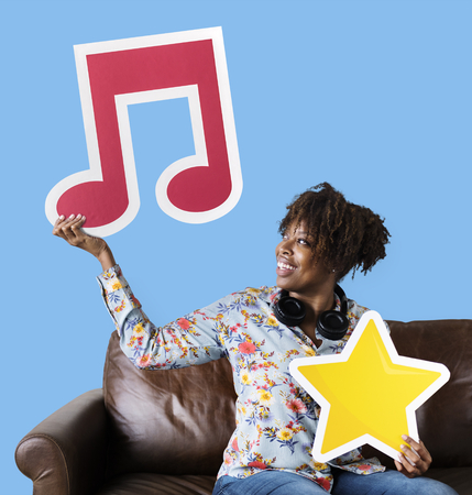 African American woman holding a musical note Stock Photo