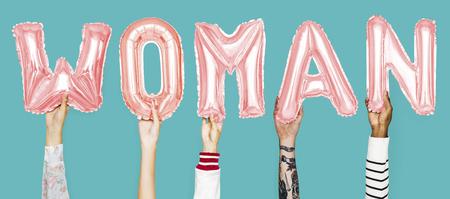 Hands showing woman balloons word Banco de Imagens