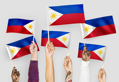 Hands waving flags of the Philippines Stock fotó