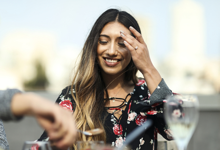 Cheerful woman enjoying a rooftop party with her friends Banco de Imagens