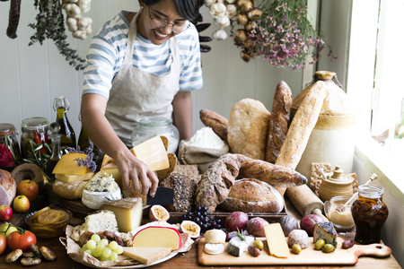 Woman selling cheese and bread Stock Photo