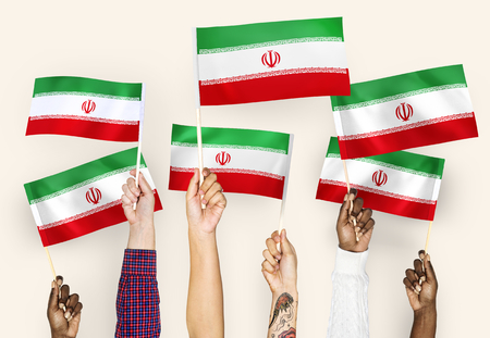 Hands waving the flags of Iran 스톡 콘텐츠