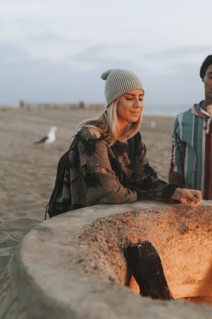 Woman looking at a bonfire