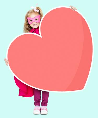 Superhero girl holding a heart icon