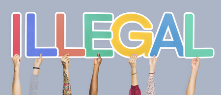 Colorful letters forming the word illegal Stock Photo