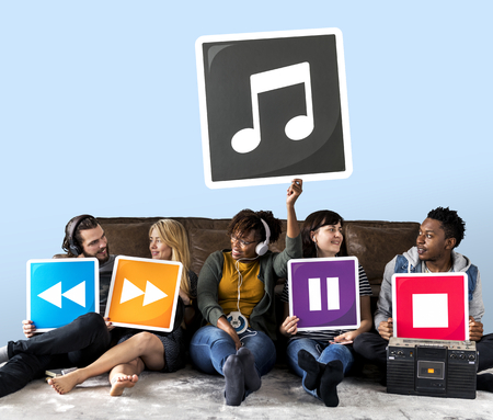 People holding media player icons and a musical note Stock Photo - 111780269