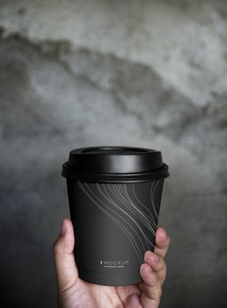 Human hand holding a mockup coffee cup Stockfoto