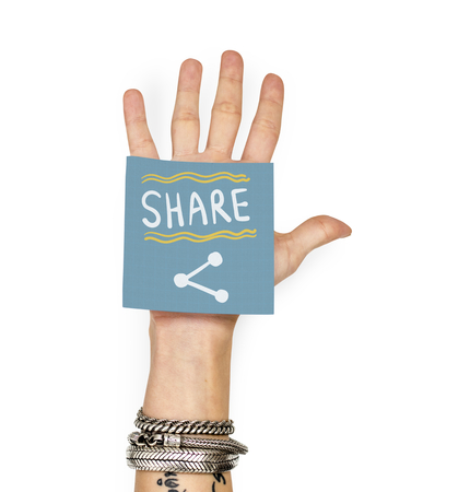 Hand showing a sticky note with Share Stockfoto