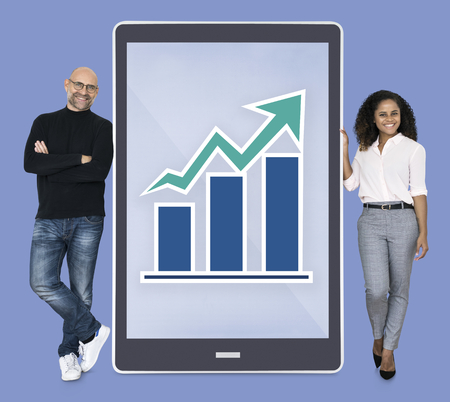 Diverse people showing bar graph on a tablet Stok Fotoğraf - 111782211