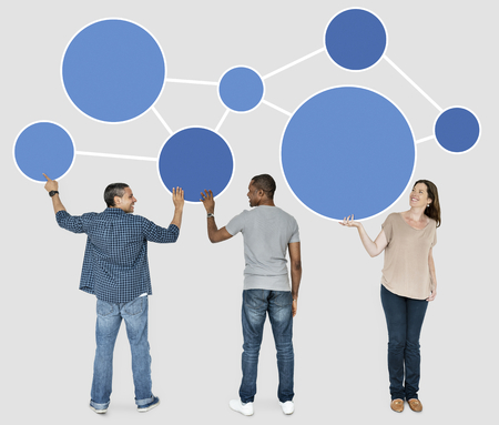 Diverse people holding blue round icons Stock fotó