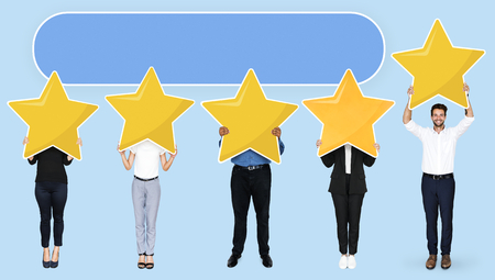 Diverse businesspeople showing golden star rating symbol Stock Photo