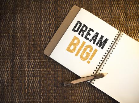 Dream big written on a notebook Stock Photo
