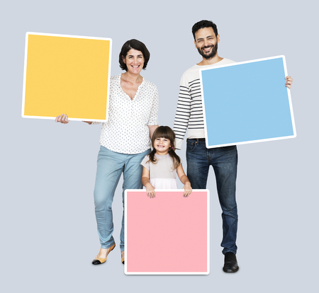 Happy family holding square shaped boards