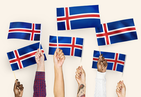 Hands waving the flags of Iceland