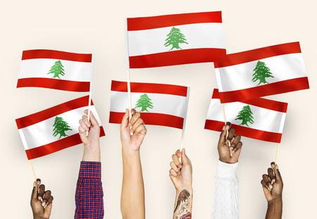 Hands waving flags of Lebanon