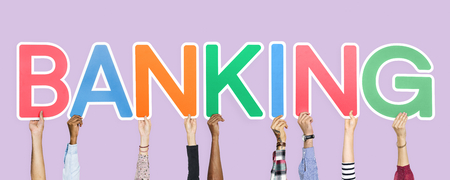 Hands holding up colorful letters forming the word banking Stock Photo