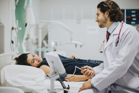 Doctor checking a patients blood pressure